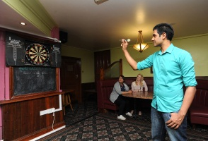 Playing darts in the Lindsay Cafe Bar