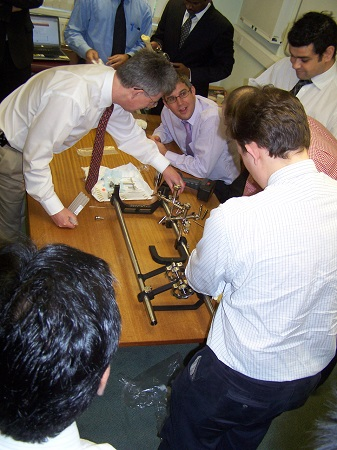 People around table looking at instrument