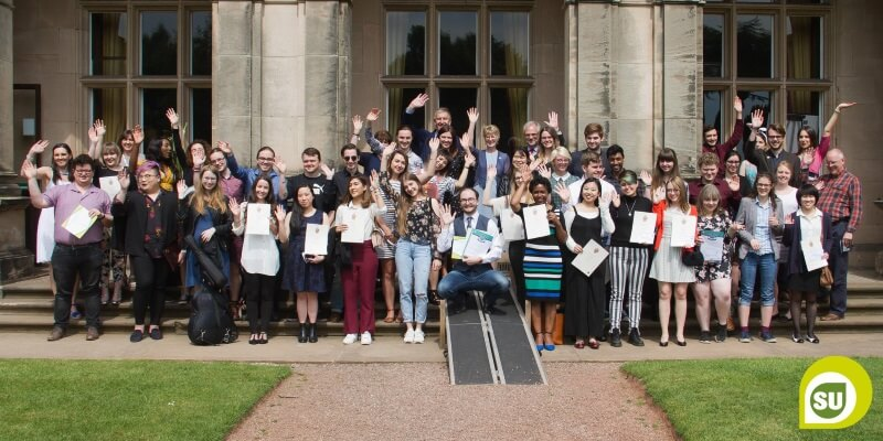 Group of Keele Volunteers smiling and holding certificates