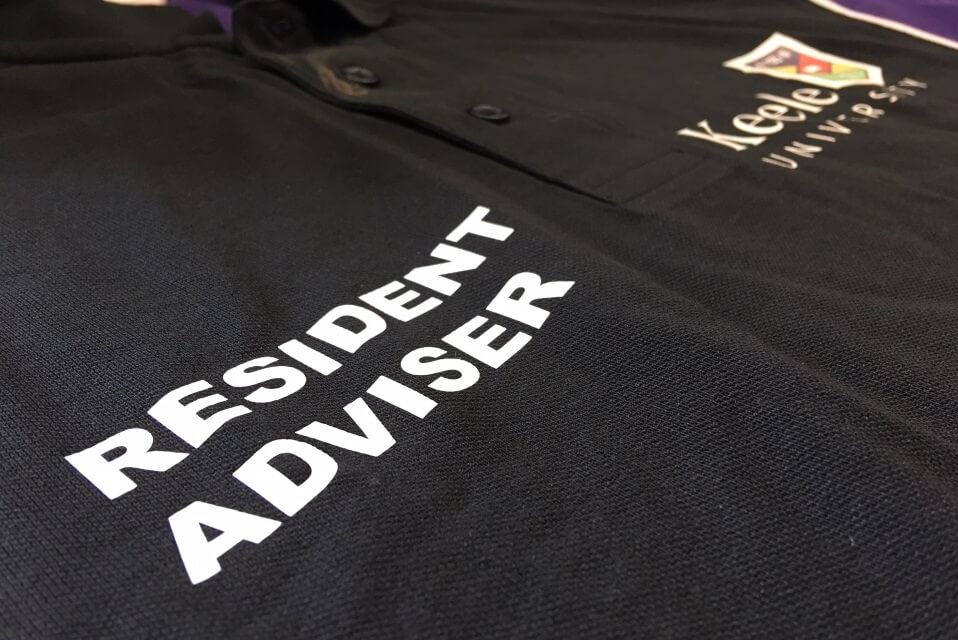 T-shirt with Resident Adviser and Keele Uni logo