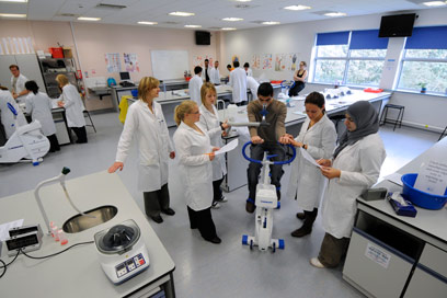 A group of student physicians gathered in a learning lab