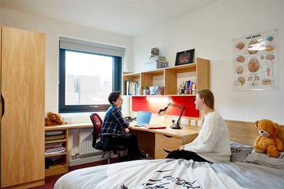 Two students relaxing in their room in Barnes Y block